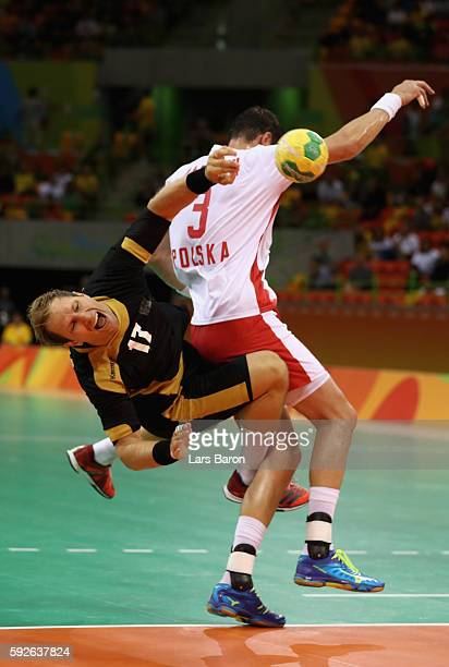 Steffen Weinhold of Germany takes a shot under pressure of Krzysztof Lijewski of Poland during the Men's Bronze Medal Match between Poland and...