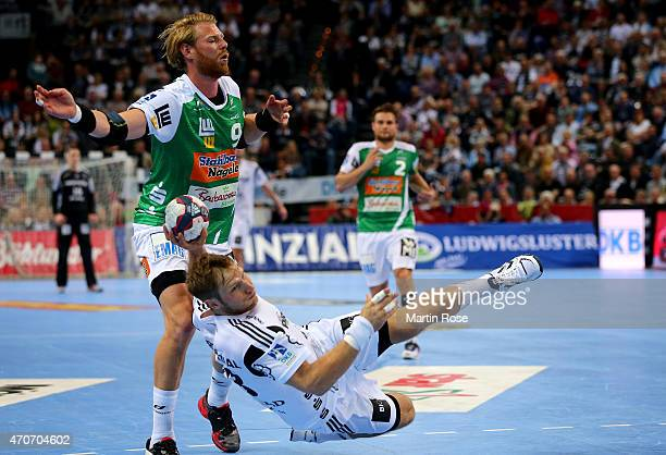 Steffen Weinhold of Kiel challenges for the ball with Manuel Spaeth of Goeppingen during the DKB HBL Bundesliga match between THW Kiel and Frisch Auf...