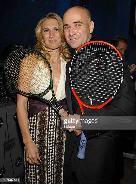 Steffi Graf and Andre Agassi holding Andre's first tennis racket when he went pro and his last tennis racket from US Open