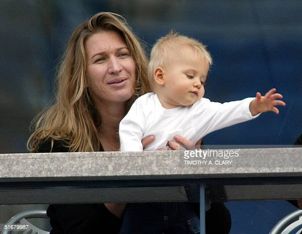 Steffi Graf and her son Jaden Gil watch as Andre Aggasi plays against Ramon Delgado of Paraguay at the 2002 US Open Tennis Tournament 31 August 2002...