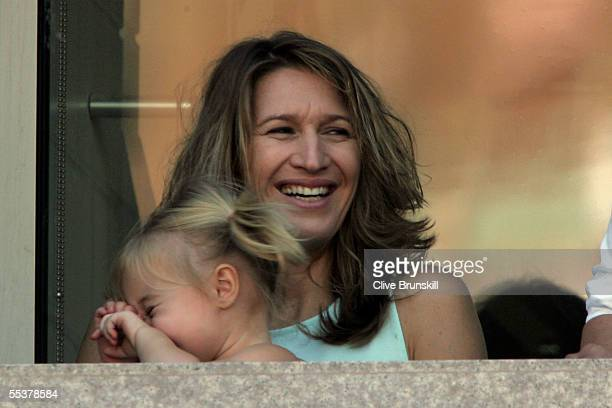 Steffi Graf Andre Agassi's wife holds their daughter Jaz Elle on her lap as Agassi takes on Roger Federer of Switzerland during the men's final of...