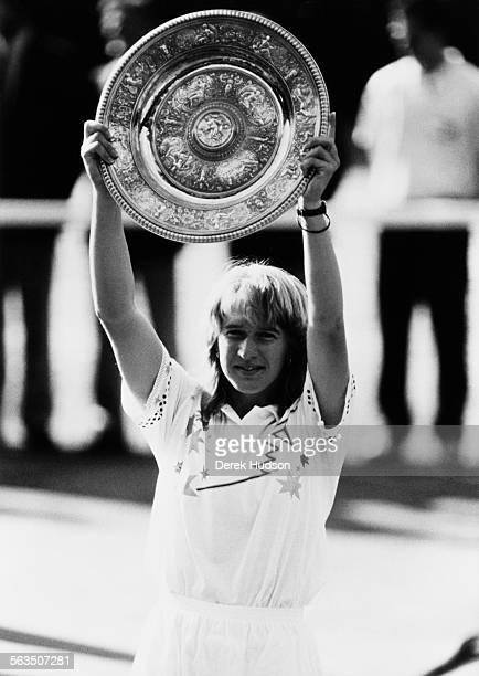 Steffi Graf collects the trophy after beating Martina Navratilova in the Women's Singles finals at Wimbledon London 2nd June 1988