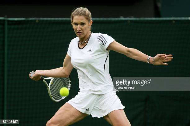 Steffi Graf hits a forehand during the Ladies Singles match against Kim Clijsters during the Centre Court Celebration at Wimbledon on May 17 2009 in...