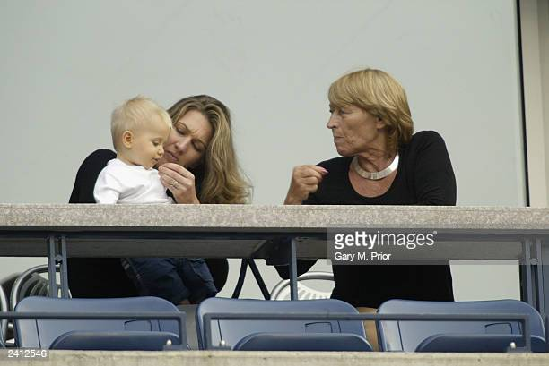 Steffi Graf of Germany and her mother Heidi play with Steffi's son during the US Open at the USTA National Tennis Center on August 31 2002 in...