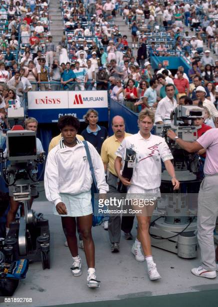 Steffi Graf of Germany and Lori McNeil of the USA walk on to court ahead of their Women's SemiFinal match in the US Open at the USTA National Tennis...