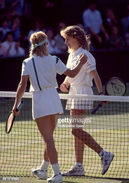 Steffi Graf of Germany and Martina Navratilova of the USA leave Centre Court after the Women's Singles Final of the Wimbledon Lawn Tennis...