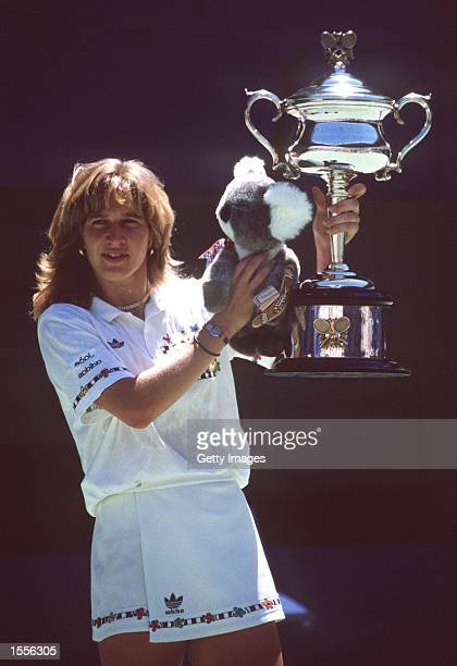Steffi Graf of Germany celebrates winning the Australian Open womens title with trophy played at Flinders Park Melbourne Australia Mandatory Credit...