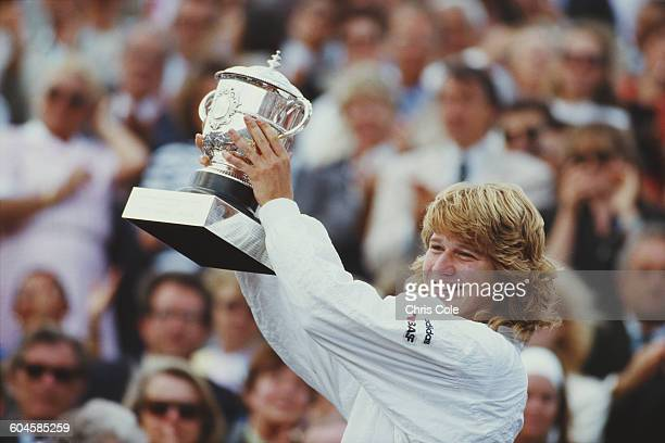 Steffi Graf of Germany celebrates with the trophy after winning her Women's Singles Final match against Martina Navratilova at the French Open Tennis...