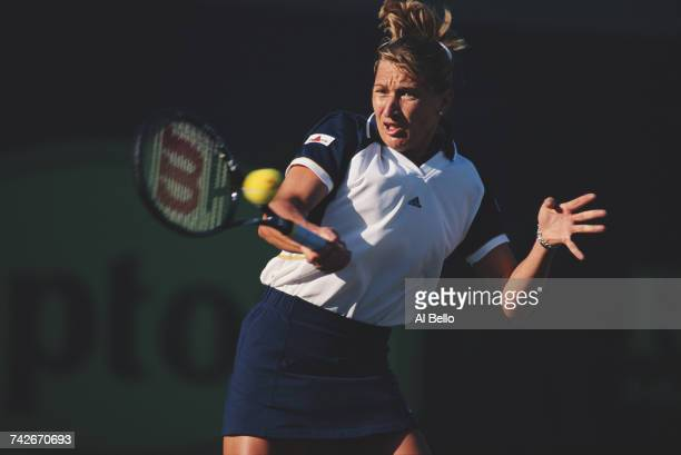 Steffi Graf of Germany eyes the ball for a forehand return against Jennifer Capriati during their Women's Singles second round match at the ATP...