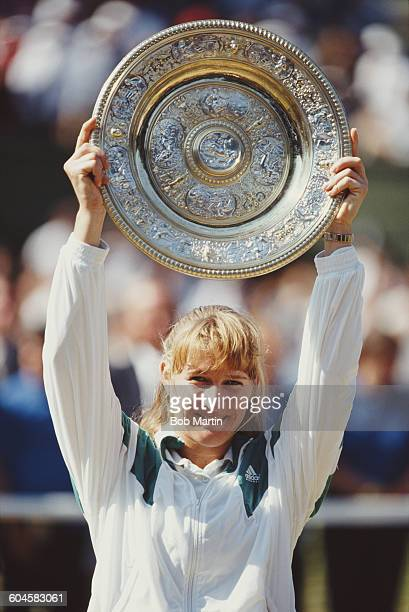 Steffi Graf of Germany holds aloft the Venus Rosewater Dish after defeating Gabriela Sabatini in the Women's Singles Final at the Wimbledon Lawn...