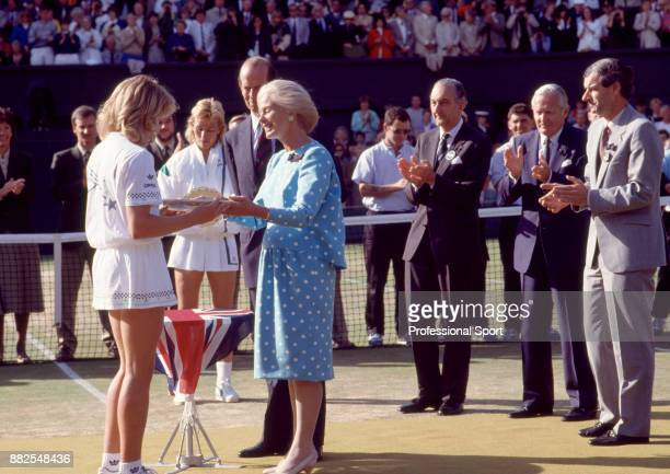 Steffi Graf of Germany is presented with the trophy by HRH the Duchess of Kent after defeating Martina Navratilova of the USA in the Women's Singles...