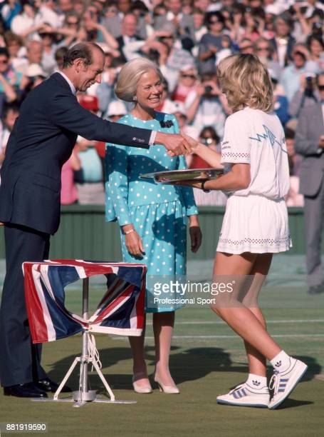 Steffi Graf of Germany is presented with the trophy by the Duke and Duchess of Kent after defeating Martina Navratilova of the USA in the Women's...