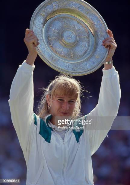 Steffi Graf of Germany lifts the trophy after defeating Gabriela Sabatini of Argentina in the Women's Singles Final of the Wimbledon Lawn Tennis...