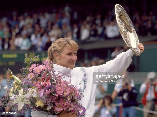 Steffi Graf of Germany lifts the trophy after defeating Martina Navratilova in the Women's Singles Final of the Wimbledon Lawn Tennis Championships...