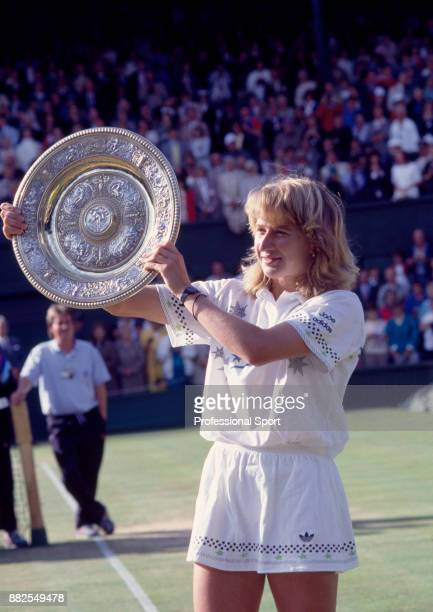 Steffi Graf of Germany lifts the trophy after defeating Martina Navratilova of the USA in the Women's Singles Final of the Wimbledon Lawn Tennis...