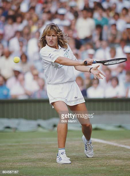 Steffi Graf of Germany makes a back hand return during the Women's Singles Final against Martina Navratilova at the Wimbledon Lawn Tennis...