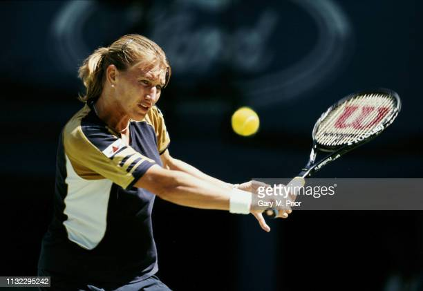 Steffi Graf of Germany makes a backhand return during her Women's Singles Fourth Round match against Barbara Schett at the Australian Open tennis...