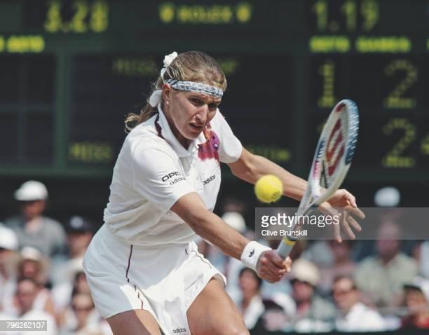 Steffi Graf of Germany makes a backhand return during the Women's Singles Final of the Wimbledon Lawn Tennis Championship against Arantxa Sanchez...