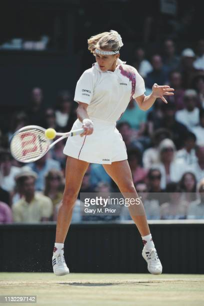Steffi Graf of Germany makes a forehand return during the Women's Singles Final of the Wimbledon Lawn Tennis Championship against Arantxa Sanchez...