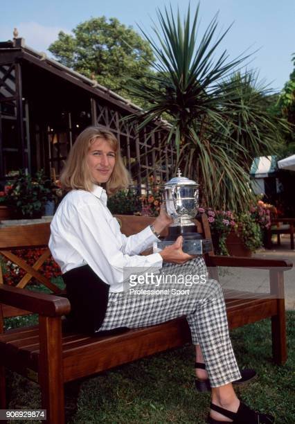 Steffi Graf of Germany photographed with her trophy after defeating Arantxa Sanchez Vicario of Spain in the Women's Singles Final of the French Open...