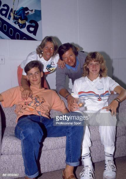 Steffi Graf of Germany poses with her family brother Michael mother Heidi and father Peter during the Lipton International Players Championships at...
