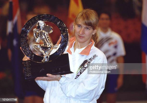 Steffi Graf of Germany poses with the trophy after defeating Arantxa Sanchez Vicario of Spain in the Singles final of the Virginia Slims Tennis...