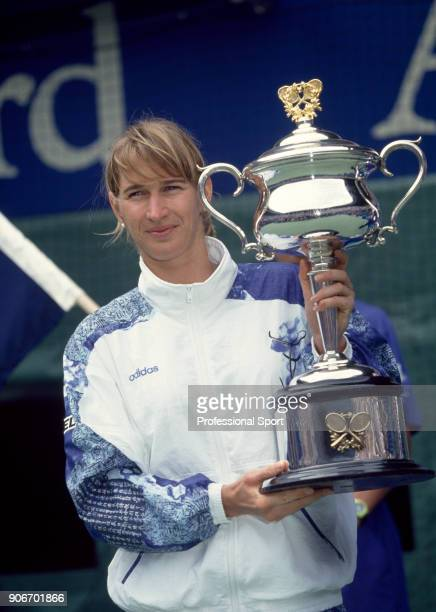 Steffi Graf of Germany poses with the trophy after defeating Arantxa Sanchez Vicario of Spain in the Women's Singles Final of the Australian Open...
