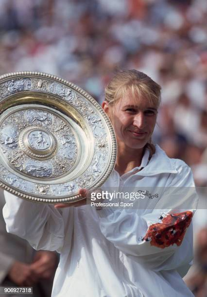 Steffi Graf of Germany poses with the trophy after defeating Arantxa Sanchez Vicario of Spain in the Women's Singles Final of the Wimbledon Lawn...