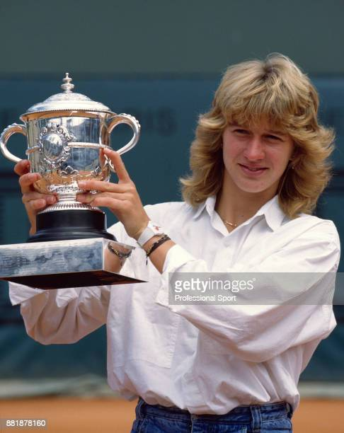 Steffi Graf of Germany poses with the trophy after defeating Martina Navratilova of the USA in the Women's Singles Final of the French Open Tennis...