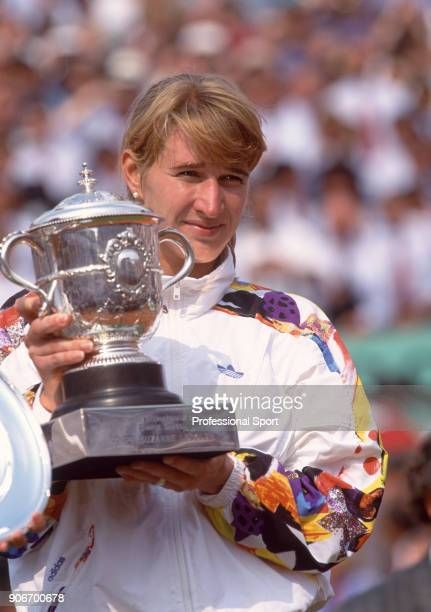 Steffi Graf of Germany poses with the trophy after defeating Mary Joe Fernandez of hte USA in the Women's Singles Final of the French Open Tennis...