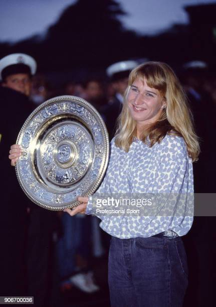 Steffi Graf of Germany poses with the trophy after defeating Monica Seles of Yugoslavia in the Women's Singles Final of the Wimbledon Lawn Tennis...