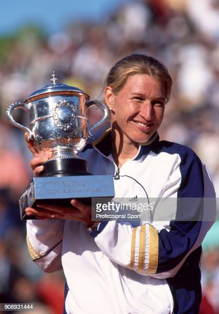 Steffi Graf of Germany poses with the trophy after her victory over Martina Hingis of Switzerland in the Women's Singles Final of the French Open...
