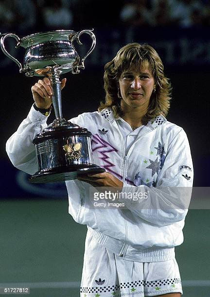 Steffi Graf of Germany raises the trophy after winning the Australian Open at Flinders Park 1988, in Melbourne, Australia.