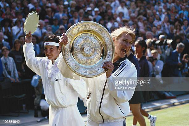 Steffi Graf of Germany salutes the crowd with the Venus Rosewater Dish after defeating Arantxa Sanchez Vicario 63 75 to win the Women's Singles Final...