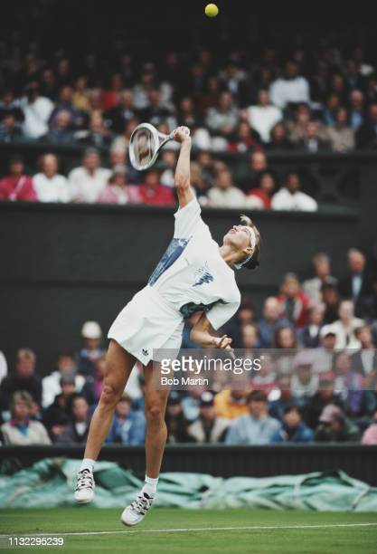 Steffi Graf of Germany serves during her Women's Singles First Round loss to Lori McNeil of the United States at the Wimbledon Lawn Tennis...