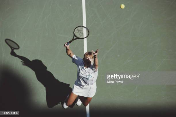 Steffi Graf of Germany serves to Gabriela Sabatini during their Women's Singles Final match of the US Open Tennis Championship on 10 September 1988...