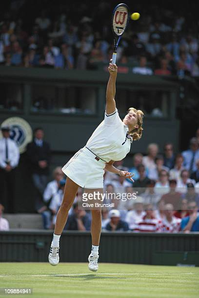 Steffi Graf of Germany serves to Jana Novotna during their Women's Singles match during the Wimbledon Lawn Tennis Championship on 25th June 1996 at...