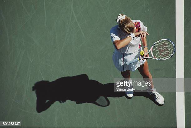 Steffi Graf of Germany serves to Nathalie Tauziat during their Women's Singles Third round match of the United States Open Tennis Championship on 31...