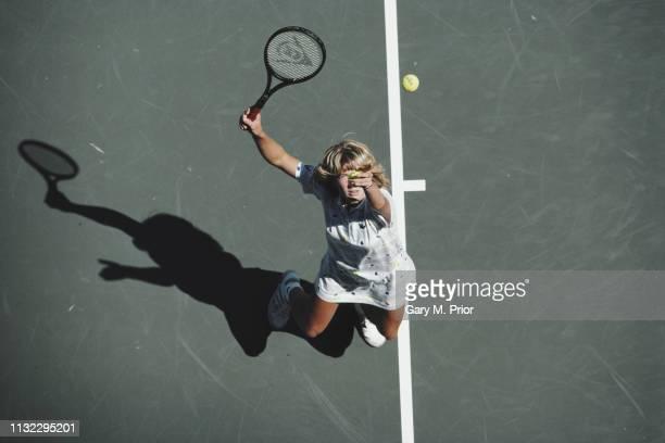 Steffi Graf of Germany serves to Raffaella Reggi during their Women's Singles Fourth round match of the United States Open Tennis Championship on 1...