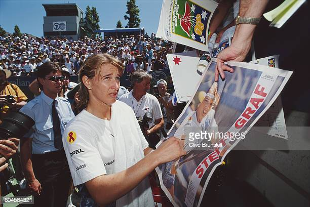 Steffi Graf of Germany signing autographs for her fans during a Women's Singles match at the Australian Open on 17 January 1994 in Flinders Park...