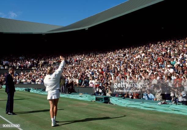 Steffi Graf of Germany waves to the crowd with her trophy after defeating Arantxa Sanchez Vicario of Spain in the Women's Singles Final of the...