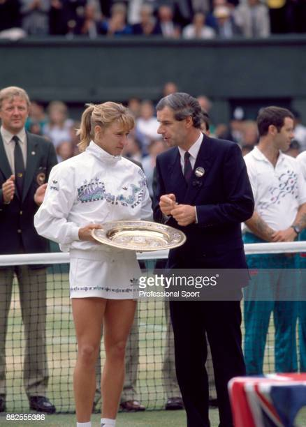 Steffi Graf of Germany with the trophy after defeating Martina Navratilova in the Women's Singles Final of the Wimbledon Lawn Tennis Championships at...