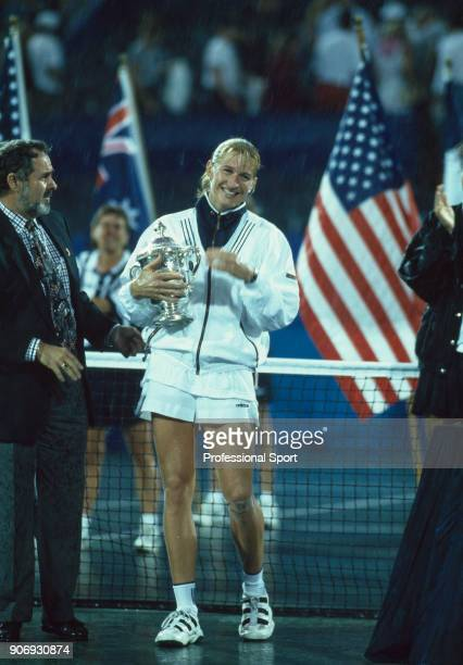 Steffi Graf of Germany with the trophy after defeating Monica Seles of the USA in the Women's Singles Final of the US Open at the USTA National...