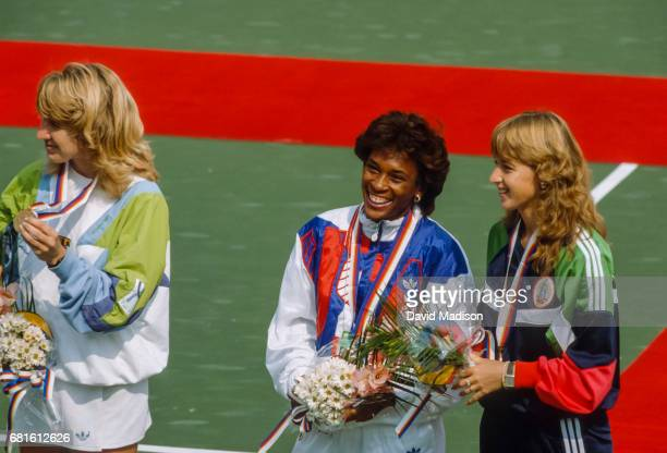Steffi Graf of the Federal Republic of Germany Zina Garrison of the United States and Manuela Maleeva of Bulgaria take part in the awards ceremony...