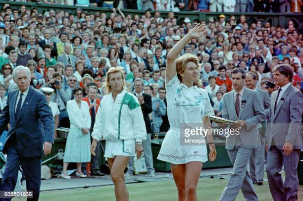 Steffi Graf pictured with a winning wave to the crowd as she walks off after the match Left is Martina Navratilova who is runner up today Steffi Graf...