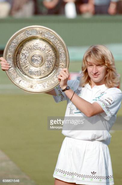 Steffi Graf pictured with her trophy the Venus Rosewater Dish Steffi Graf beats current 6 times defending champion Martina Navratilova to win the...