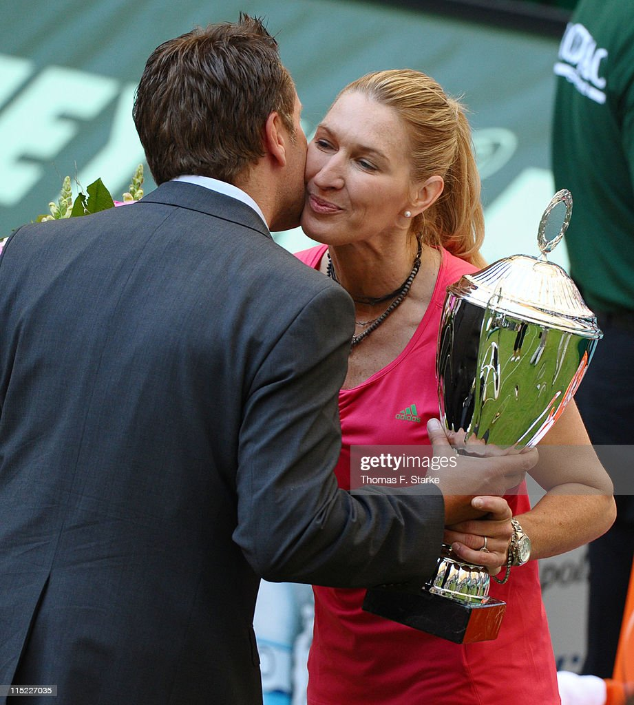 Steffi Graf (R) receives the cup by tournament director Ralf Weber after the Warsteiner Champions Trophy of the Gerry Weber Open at the Gerry Weber stadium on June 4, 2011 in Halle, Germany.