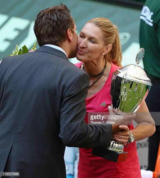 Steffi Graf receives the cup by tournament director Ralf Weber after the Warsteiner Champions Trophy of the Gerry Weber Open at the Gerry Weber...