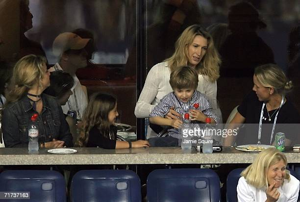 Steffi Graf wife of Andre Agassi and their son Jaden Gil watch Agassi play against Andrei Pavel of Romania during the first round of the US Open at...