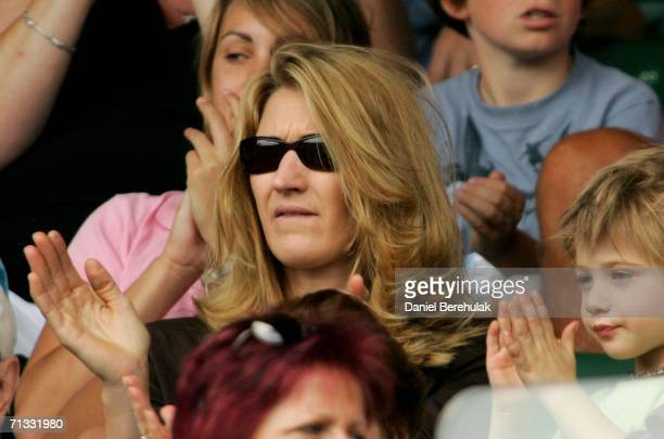 Steffi Graf wife of Andre Agassi and their son Jaden Gil watch Andre Agassi of The United States and Andreas Seppi of Italy on Centre Court during...